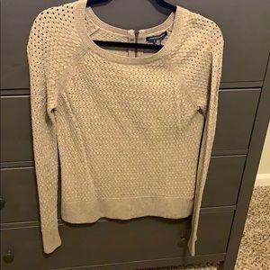 Light brown knit sweater.